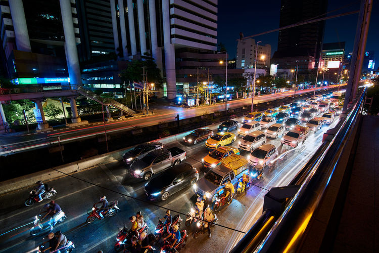 City Night Illuminated Architecture Transportation Built Structure High Angle View Street Building Exterior City Life Road Mode Of Transportation Motion Traffic City Street Blurred Motion Land Vehicle Speed Car Motor Vehicle Outdoors Nightlife Traffic Long Exposure