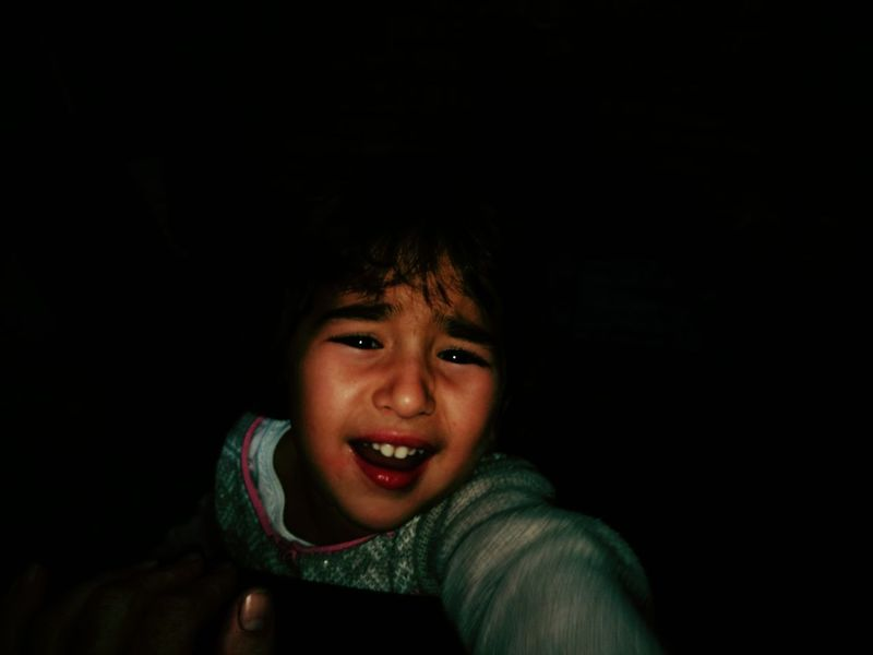 EyeEm Selects distressed little girl Child Children Only Childhood Smiling One Person Portrait Looking At Camera Indoors  Human Body Part Headshot Cheerful People Real People Close-up Day Girl Distress Dark