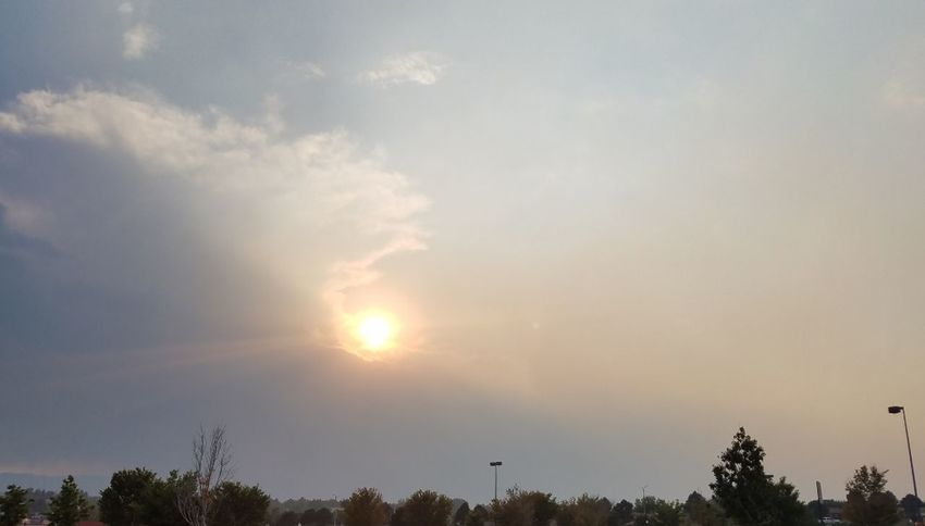 Sun Setting Behind Smoke Haze From West Coast And Clouds