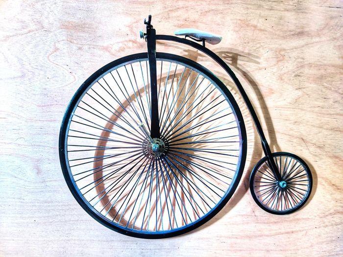 High angle view of bicycle wheel on wood