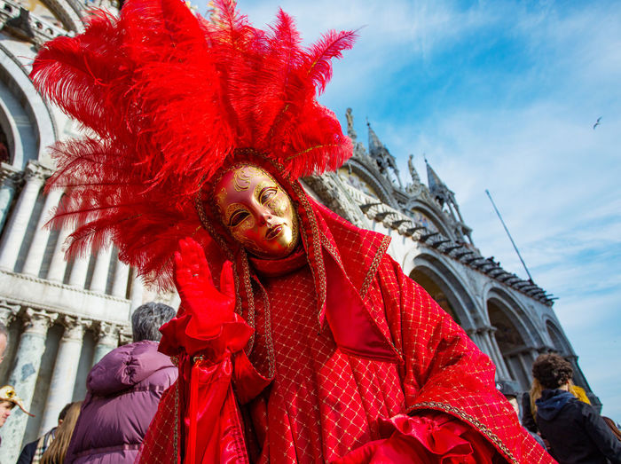Carnival Carnival In Venice Architecture Building Exterior Built Structure Carnival Costumes City Close-up Day Low Angle View Mask One Person Outdoors People Red Sky Statue Travel Destinations