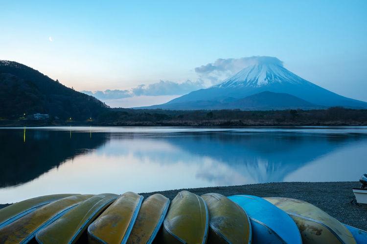 Mount fuji. view at lake shoji in the morning with row of boats. fuji five lake, yamanashi, japan.