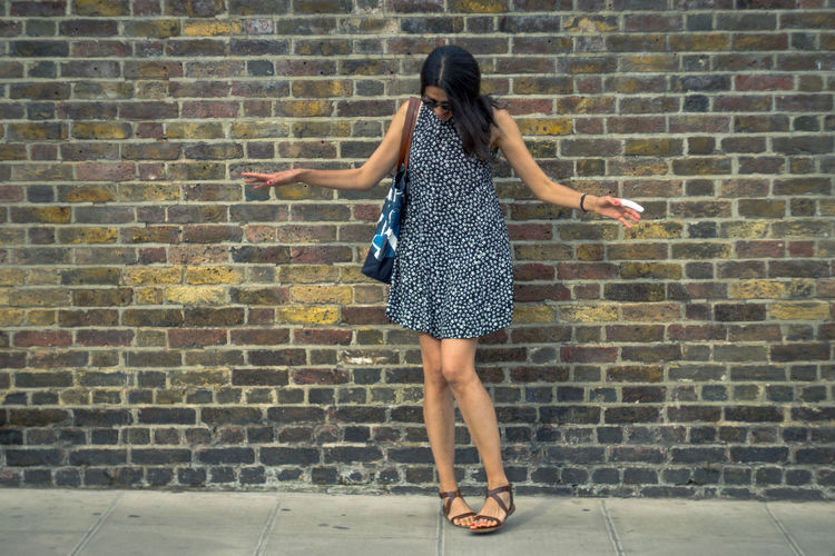 Adult Brick Wall Capture The Moment Cheerful City Day Dress Fashion Full Length Fun Happiness London Lifestyle Looking Down Motion Notting Hill One Person Outdoors Real People Street Fashion Women light and reflection Enjoy The New Normal Woman London City Life Streetphotography My Year My View Uniqueness The Portraitist - 2017 EyeEm Awards EyeEm LOST IN London EyeEm Selects EyeEmNewHere Love Yourself Press For Progress