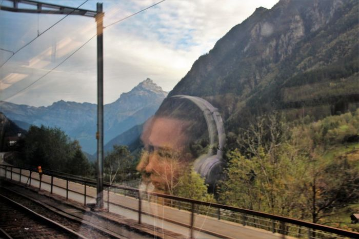 Train Journey Beauty In Nature Cloud Cloud - Sky Cloudy Day Headphones Landscape Mountain Mountain Range Nature Non-urban Scene Outdoors Reflection Scenics Showing Imperfection Sky Teenager Tourism Train Journey Tranquility Travel Destinations
