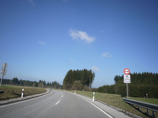 Trafficsign in south Germany Allgäu Guiding Traffic Clear Sky Communication Day Guidance Guide Highway Landscape Nature No People Outdoors Road Road Marking Road Sign Scenics Sky Speed Limit Sign The Way Forward Traffic Sign Transportation Tree