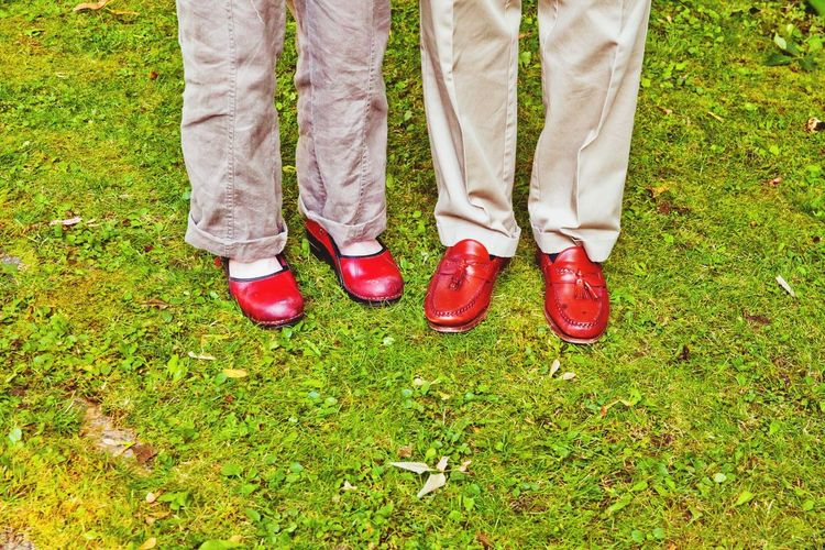 Man And Woman In Red Shoes On Grass
