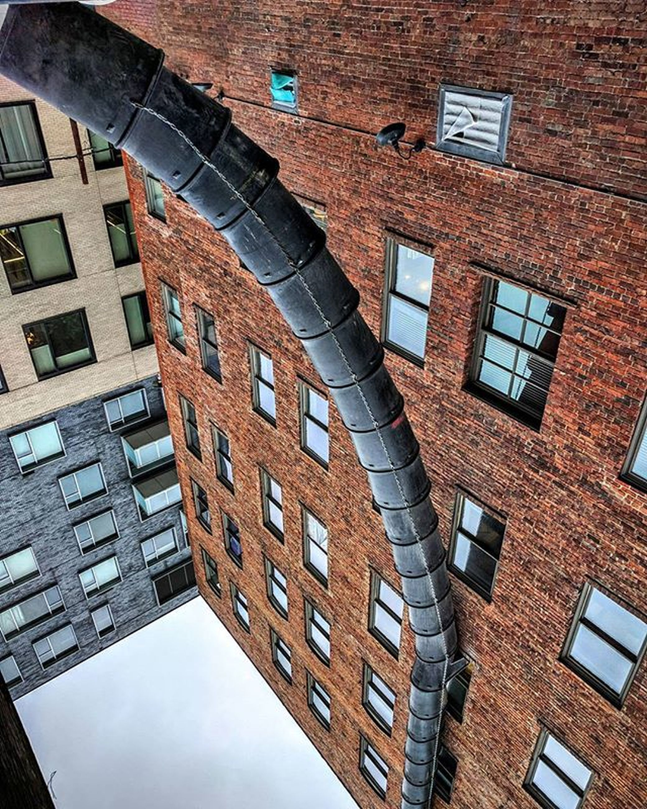 architecture, building exterior, built structure, low angle view, window, building, residential building, city, residential structure, reflection, full frame, day, outdoors, no people, backgrounds, glass - material, repetition, balcony, in a row, brick wall