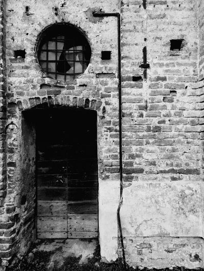 Monochrome Photography Architecture Built Structure Building Exterior Window Closed Wall - Building Feature Old Arch Full Frame Outdoors Exterior Day Weathered Arched Entryway Façade