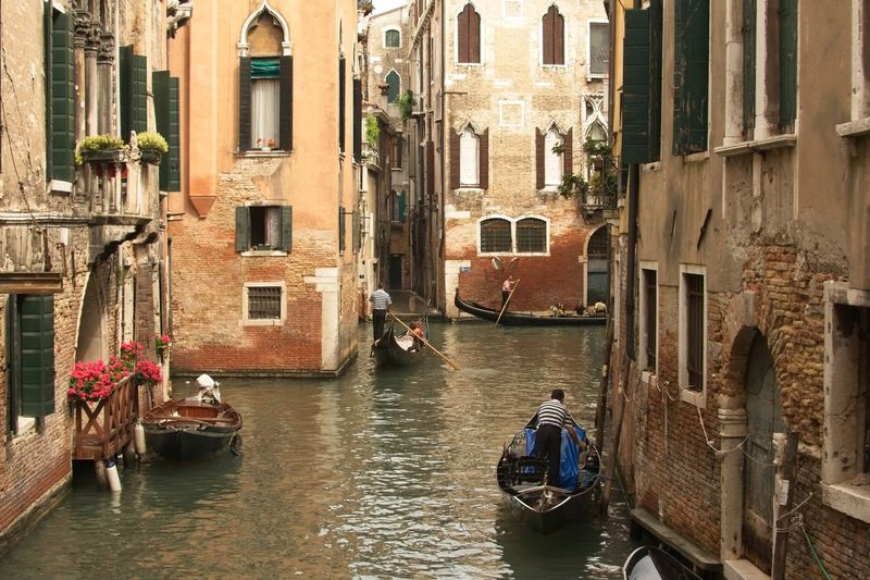Venetian waterways. Gondola - Traditional Boat Italy Travel Destinations Venice Building Exterior Water Architecture Built Structure Mode Of Transportation Transportation Nautical Vessel Building Canal Travel