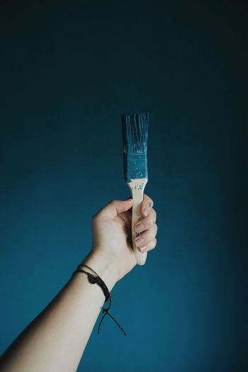 Human Hand Holding Indoors  Front View Hand Paint Brushed Holditup Blue Blue Color Painting Shooting Human Body Part One Person Sweet Food Ice Cream Cone Frozen Food People Food And Drink Ice Cream One Woman Only Only Women Adults Only Close-up Adult