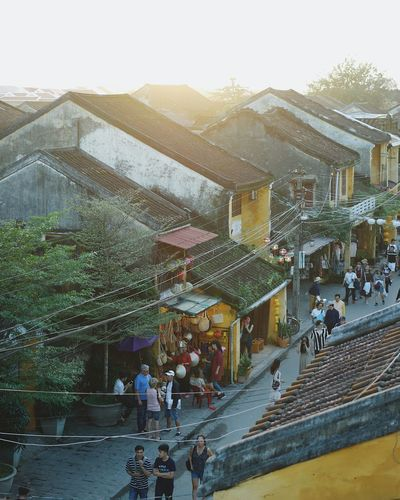 High angle view of people on street amidst buildings in city