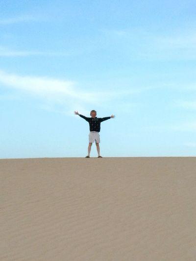 Sand Dune Desert Full Length Beach Blue Sand Arid Climate Standing Human Arm Well-dressed Countryside Shore Tranquil Scene Calm Tranquility Coast
