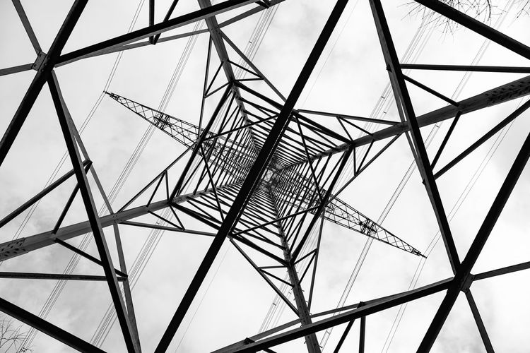 Low Angle View Sky Built Structure Metal Architecture No People Electricity Pylon Technology Pattern Connection Fuel And Power Generation Power Supply Outdoors Electricity  Tall - High Complexity Power Line  Directly Below Iron - Metal Girder Steel Electrical Equipment Black And White