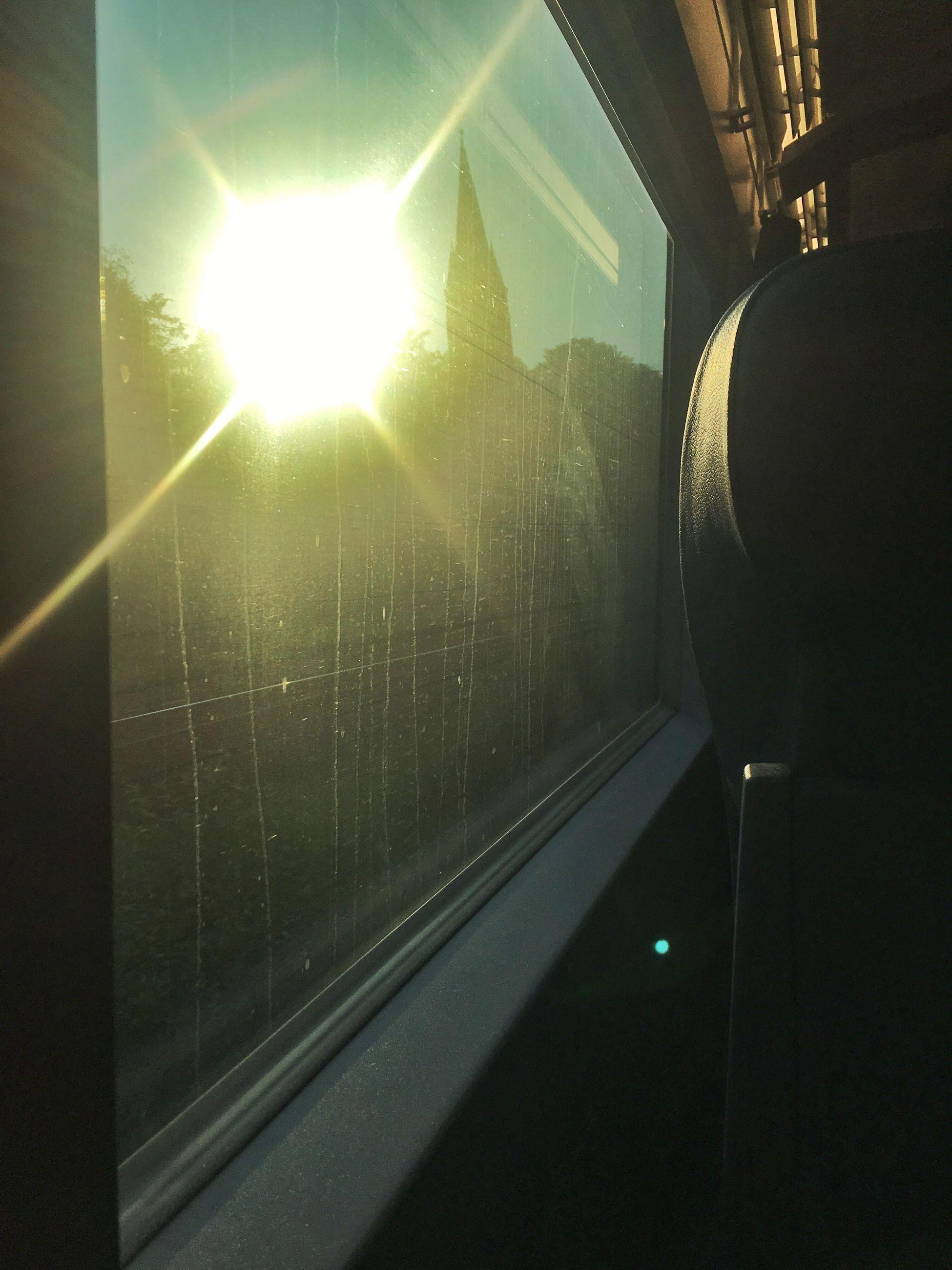 transportation, window, public transportation, railroad track, indoors, illuminated, railroad station, mode of transport, railroad station platform, subway station, lens flare, sun, bright, journey, no people, public transport