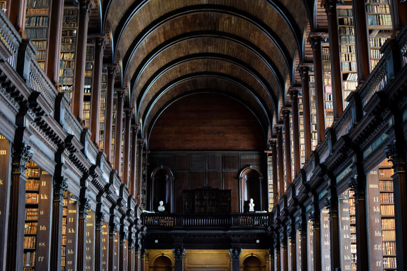 Trinity College Library Books Library Philosophy Trinity World Heritage Arcade Arch Arched Architectural Column Architecture Building Building Exterior Built Structure Culture History In A Row Literature Low Angle View No People Outdoors The Past Travel Travel Destinations Wallpaper Wood - Material