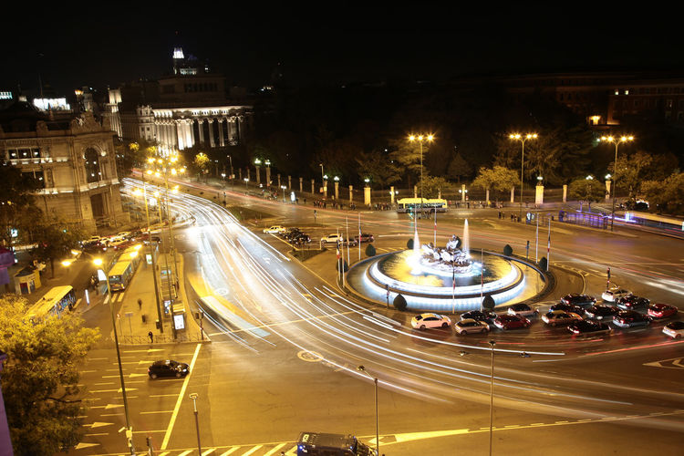 A long-exposure night view of the Plaza de Cibeles in Madrid, Spain Blurred Motion Car City Life Fountain Light Long Exposure Night Road Spain, Madrid, Tourism, Tourist, Buildings Speed Statue Traffic Urban