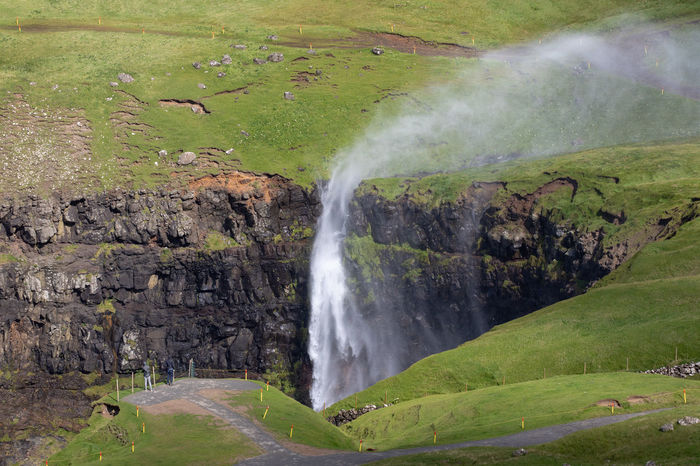 Gasadalur Beauty In Nature Blurred Motion Environment Faroe Islands Flowing Water Green Color Land Long Exposure Motion Múlafossur Nature No People Outdoors Plant Power Power In Nature Rainbow Rainforest Rock Rock - Object Scenics - Nature Solid Water Waterfall