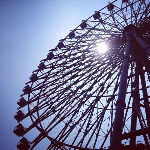 Low Angle View Amusement Park Sunlight Outdoors Ferris Wheel Arts Culture And Entertainment Japan