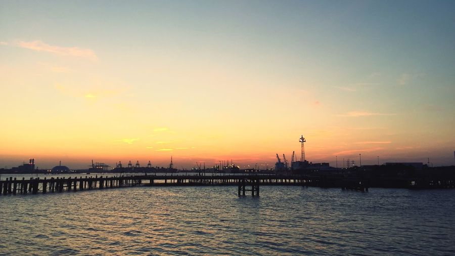 Silhouette Pier Over Sea Against Sky During Sunset