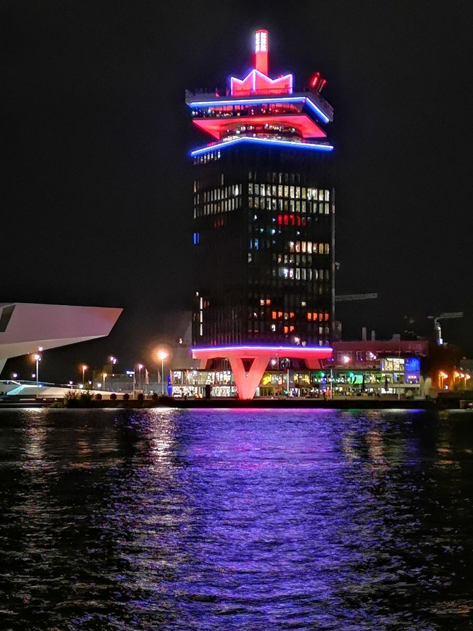 ILLUMINATED BUILDING BY RIVER