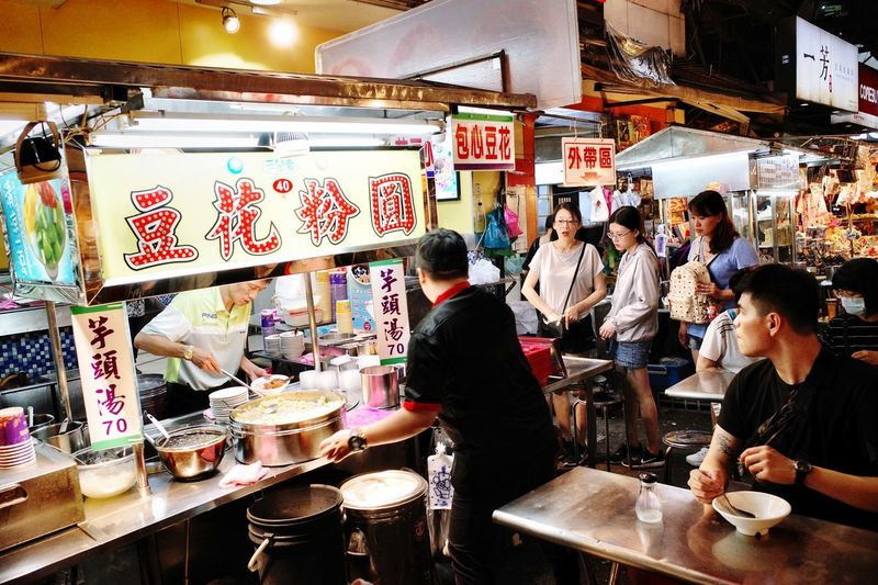Taiwan Food Taiwan Ricoh GRlll Food And Drink Real People Illuminated Restaurant Business Cafe Group Of People People Adult Small Business Food Men Choice Lifestyles Customer  Retail  Indoors  Women Bar - Drink Establishment Communication