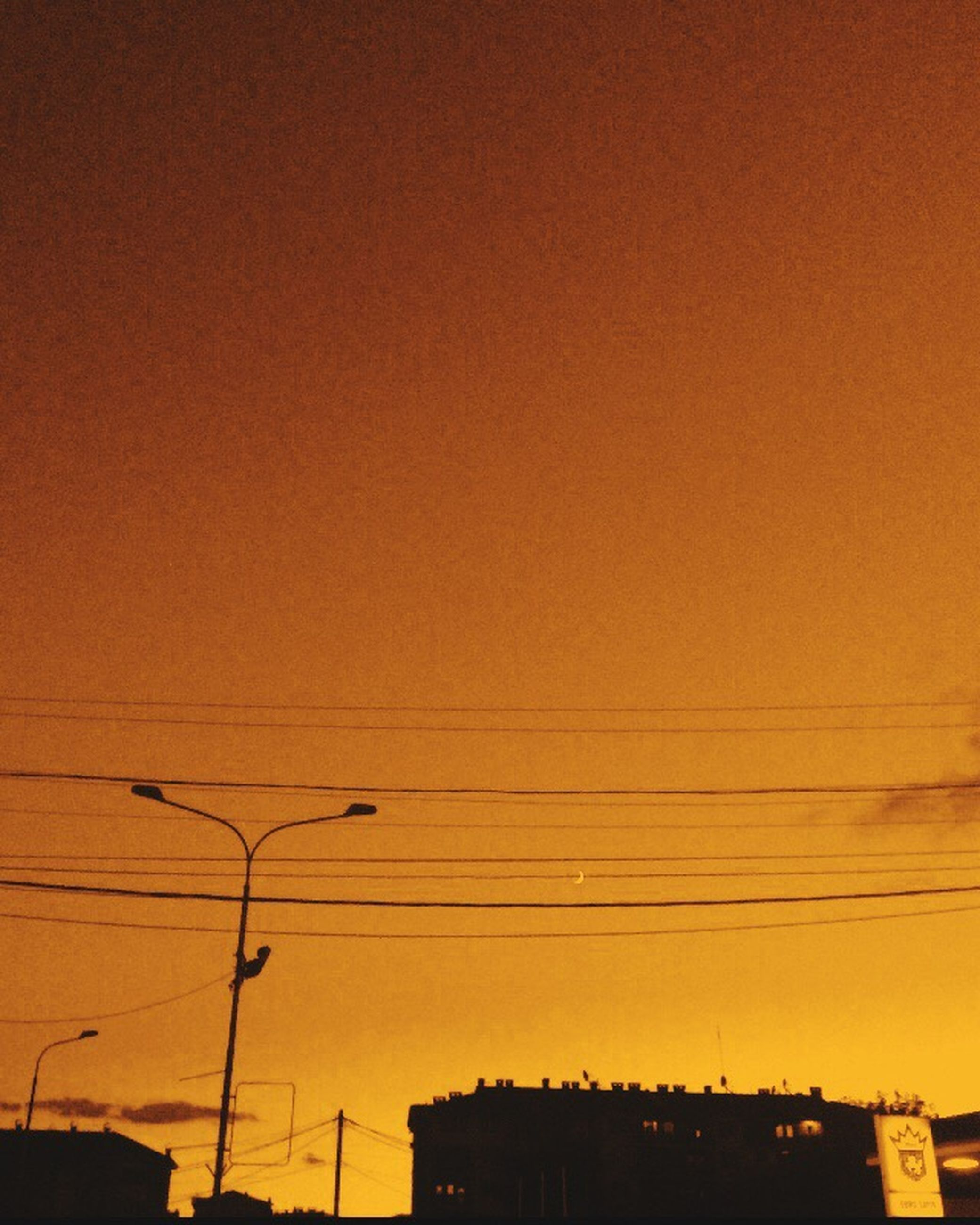 sunset, power line, architecture, built structure, low angle view, orange color, cable, sky, power supply, building, city, power cable, outdoors, no people, high section, nature, beauty in nature, dark