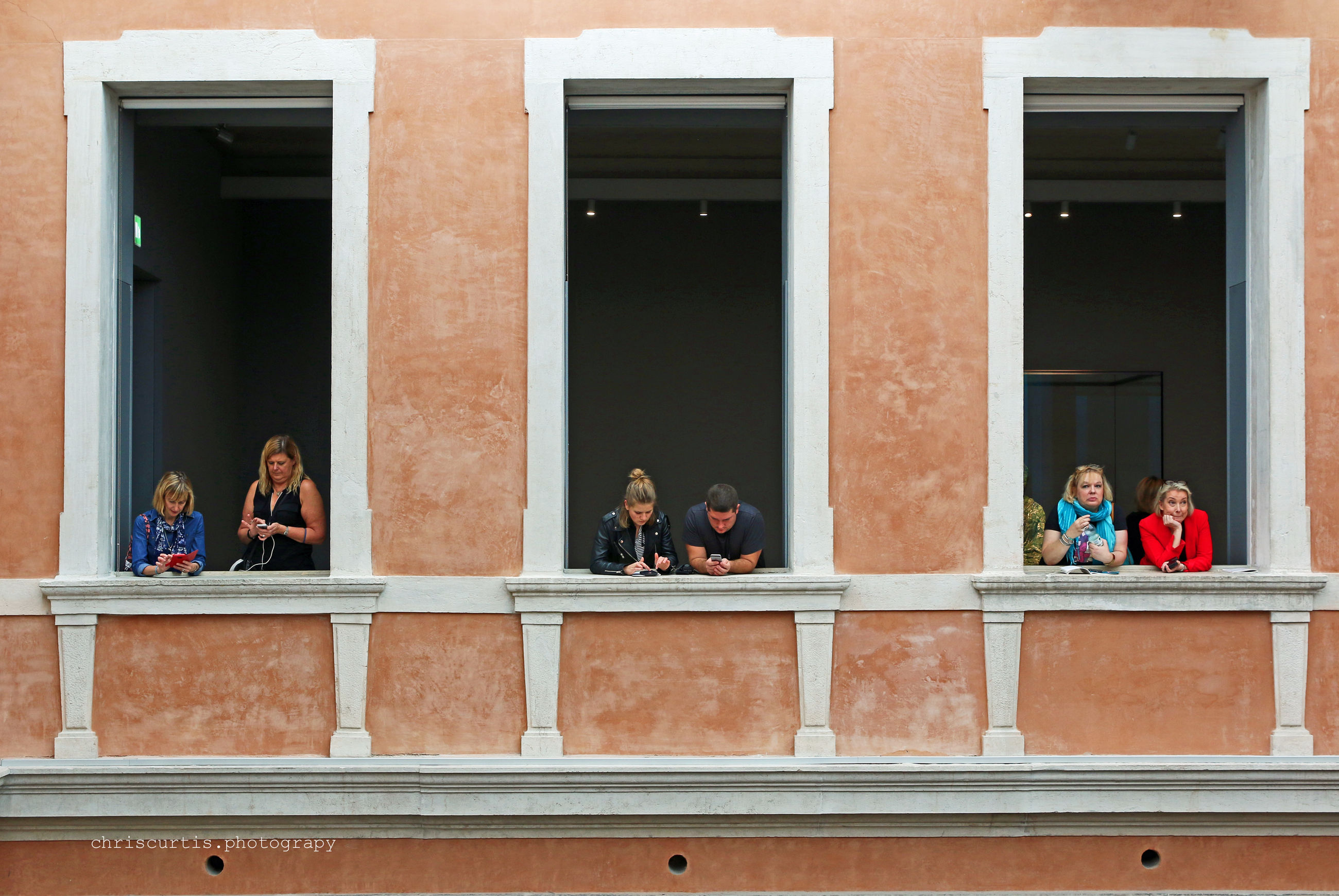 PEOPLE USING PHONE ON WINDOW