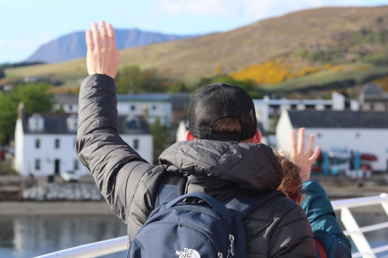 Leaving the Highlands on a ferry Ullapool Highlands Of Scotland VisitScotland Scotland Bon Voyage Waving Hand Waving Goodbye Unrecognizable Person Real People One Person Leisure Activity Lifestyles Focus On Foreground Day Nature Architecture Clothing Rear View Mountain Warm Clothing Portrait Outdoors Women Men Built Structure Water Human Arm