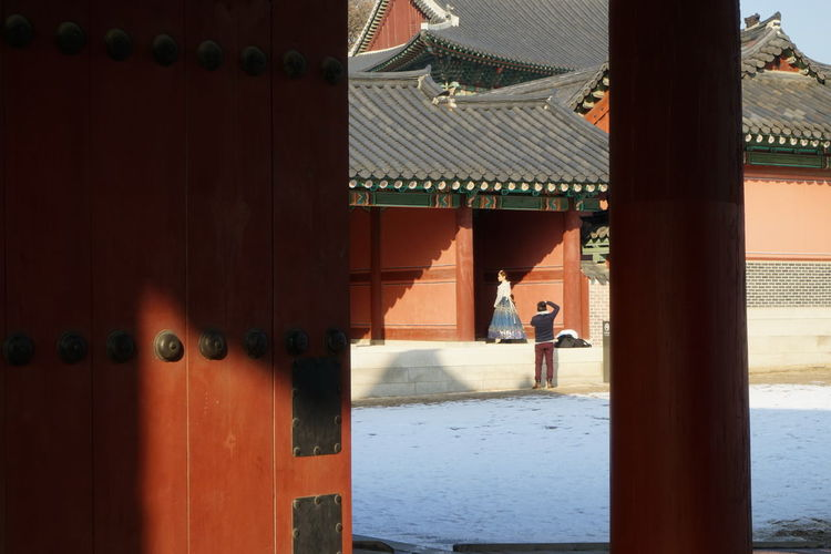 Changduk Palace Korean Traditional Architecture UNESCO World Heritage Site Winter Architecture Built Structure Cold Temperature Day Lifestyles Outdoors People Real People Seoul City Shadow Snow Standing Travel Destinations