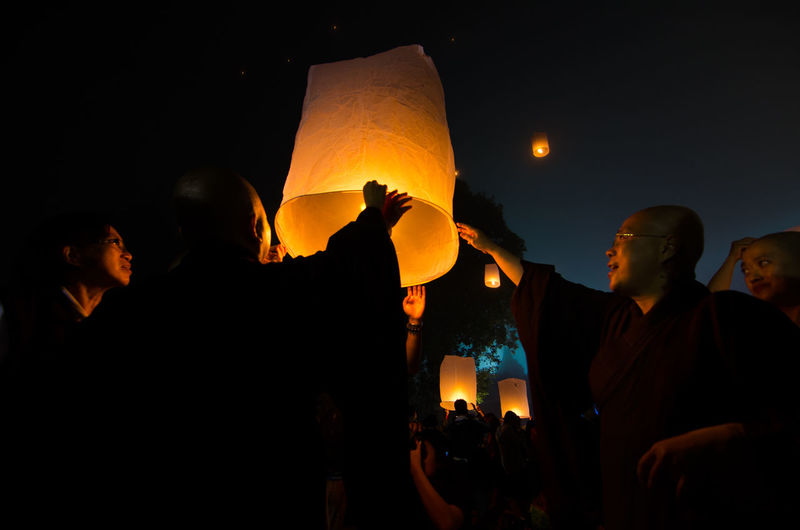 15 may 2014, Magelang, Indonesia : Participants releasing lanterns over the Borobudur temple in Magelang, Central Java during Vesak/Waisak Day celebrations. Architecture Belief Burning Group Of People Illuminated Lantern Leisure Activity Lifestyles Lighting Equipment Men Nature Night Outdoors Paper Lantern People Real People Religion Sky Spirituality Women