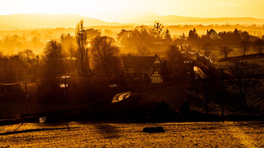 The setting sun backlights low level fog during the first sunset of 2017 visible from North Herefordshire, this was taken on the outskirts of the rural town of Leominster Backlit Countryside Day Dusk Fog Foggy Weather Herefordshire Leominster Nature No People Outdoors Rural Sunset Sunset #sun #clouds #skylovers #sky #nature #beautifulinnature #naturalbeauty #photography #landscape Tree Uk Winter