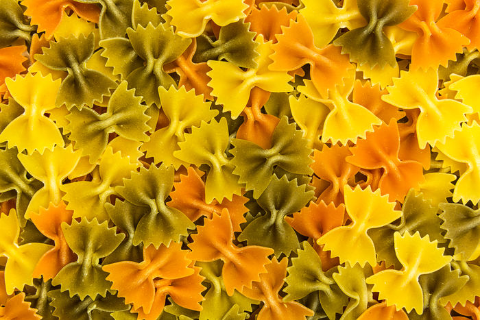 Farfalle italian Noodles colored background texture Colors Diet Food And Drink Noodles Raw Vegetarian Vitamins Backgrounds Carbohydrates Colorful Eat Egg Farfalle Food Heap Italanfood Italian Italy Macaroni Pasta Pasta Time Pastalover Pattern Uncooked