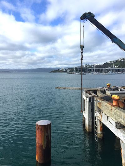 Crane piece dangling over the side of the wharf Water Outdoors Crane Crane - Construction Machinery Chain Harbour Wellington Harbour Dangling