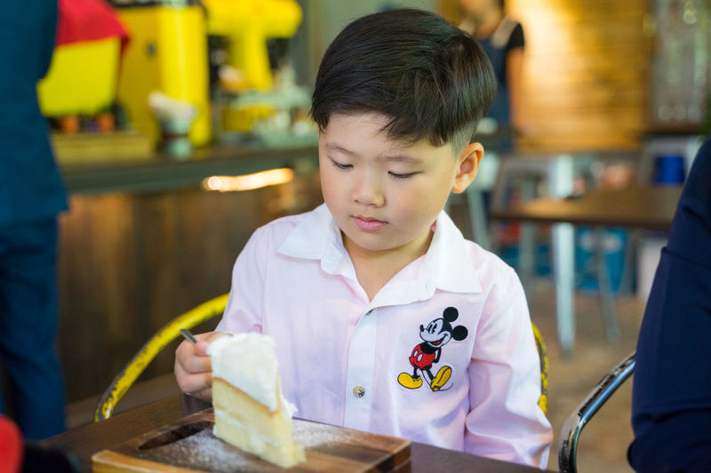Boy looking away at restaurant table
