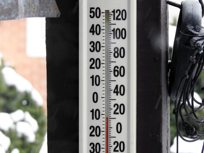 An outdoor thermometer shows the temperature near zero in Chicago during the winter. Freezing Accuracy Close-up Day Gauge Heat - Temperature Instrument Of Measurement No People Outdoors Thermometer Zero Degrees