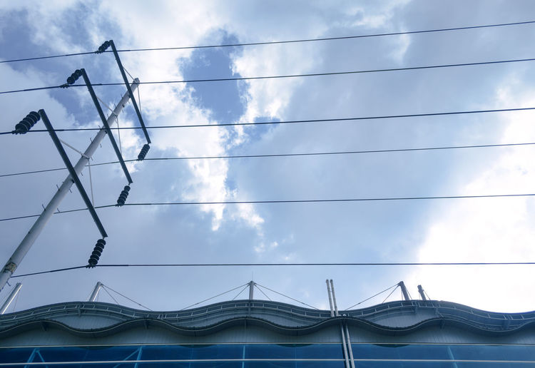 Architecture Blue Blue Sky Built Structure Cable Cloud Cloud - Sky Cloudy Connection Curves And Lines Day Low Angle View Nikon Nikon D5100  Nikonphotography No People Outdoors Power Cable Power Line  Power Supply Sky Taking Photos Wire