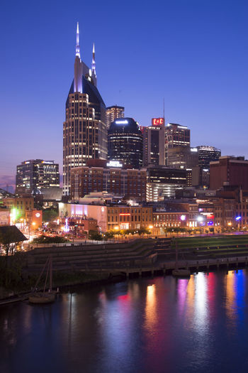 Nashville Nasville Architecture Building Building Exterior Built Structure City Cityscape Clear Sky Dusk Illuminated Modern Nature Night No People Office Building Exterior Outdoors Reflection River Sky Skyscraper Tower Travel Destinations Water Waterfront