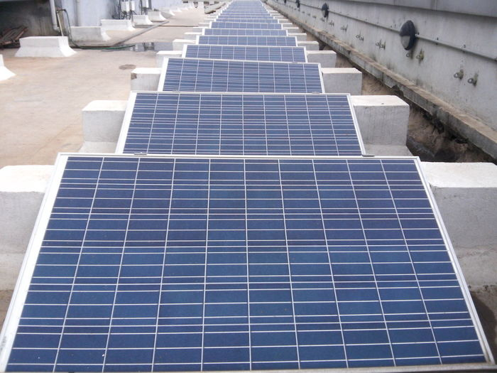 High angle view of solar panels on building terrace