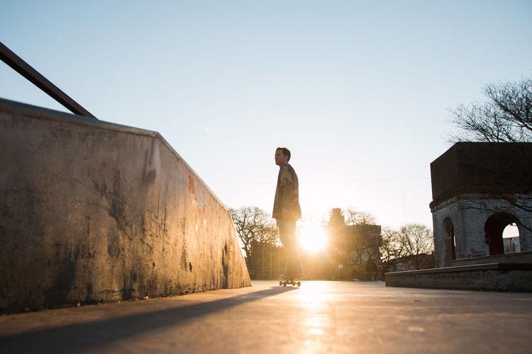Silhouette of skateboarder in sunset