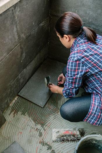 High angle view of woman using mobile phone