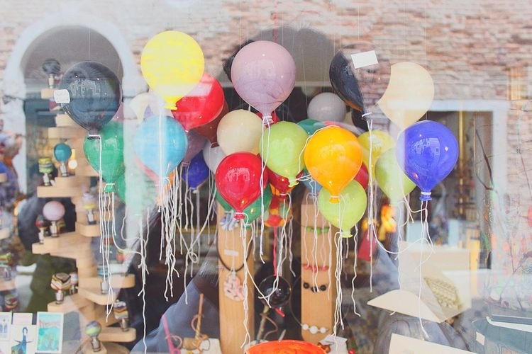 Colorful Balloons In Store Seen Through Glass