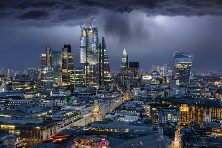 Thunderstorm over the modern skyline of the City of London, UK, by night Building Exterior Architecture Built Structure City Building Sky Illuminated Cloud - Sky Night Cityscape Skyscraper High Angle View Urban Skyline Financial District  Travel Destinations Tall - High Office Building Exterior Thunderstorm Lightning Rain Brexit Modern London City Of London United Kingdom
