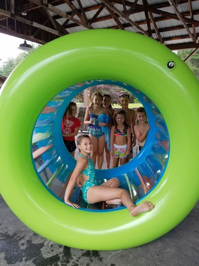 That's a big hamster wheel EyeEm Selects Friendship Water Child Water Slide Childhood Togetherness Boys Males  Smiling Playing Inflatable Ring Inflatable  Pool Party Raft Float Outdoor Play Equipment Sibling Sister Brother Beach Party