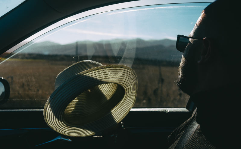 Portrait of man seen through car window