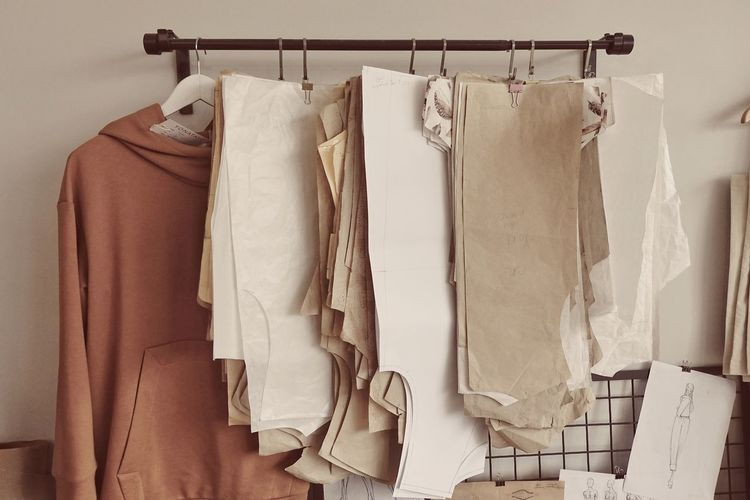 White clothes hanging on rack