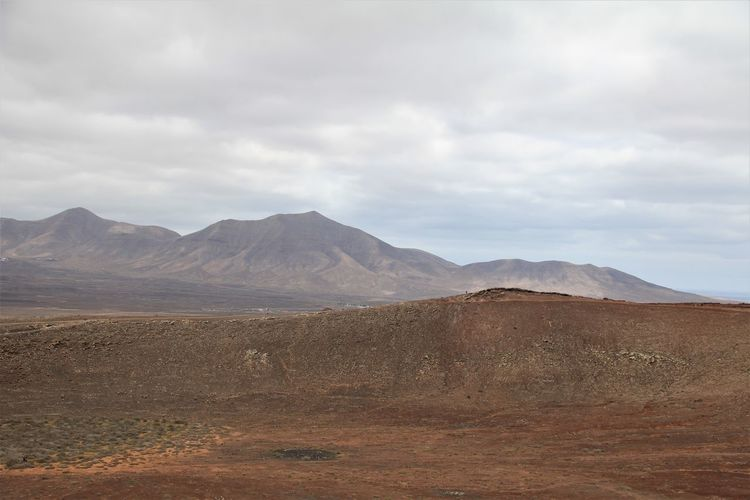 Environment Landscape Sky Tranquil Scene Scenics - Nature Cloud - Sky Mountain Tranquility Beauty In Nature Land Non-urban Scene Day Nature No People Remote Idyllic Physical Geography Mountain Range Geology Outdoors Climate Arid Climate Volanic Playa Blanca Lanzarote