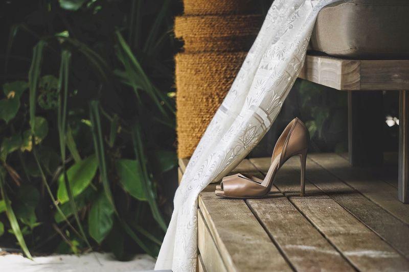 Close-up of sandal on floorboard