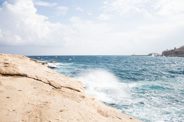 Sea Water Sky Scenics - Nature Beauty In Nature Motion Rock Horizon Land Wave Cloud - Sky Beach Sport Rock - Object Nature Day Surfing Outdoors Power In Nature Breaking Travel Destinations