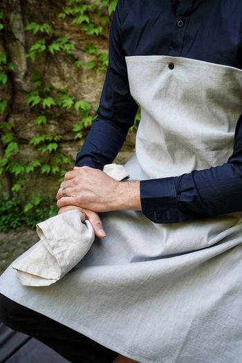 Close-up of man holding hands with cloth