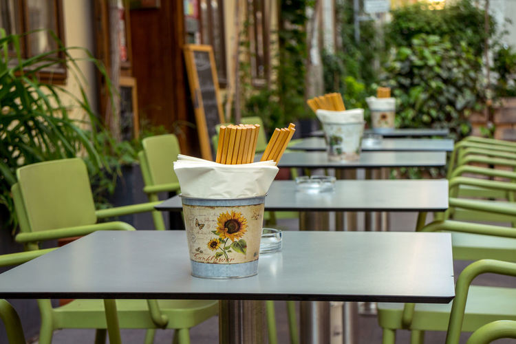 Chairs and tables at sidewalk cafe
